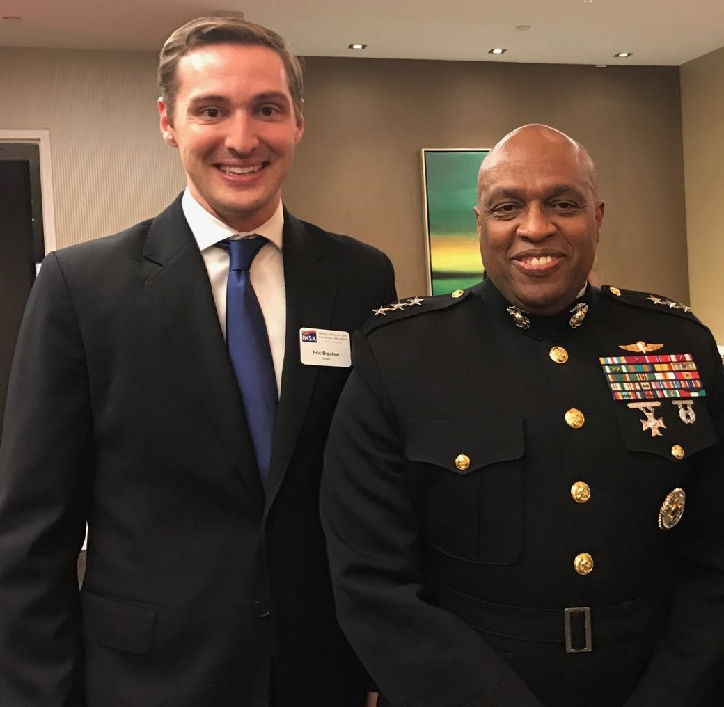 INSA intern Eric Bigelow with DIA Director Lt. Gen. Vincent Stewart, USMC, at an INSA Leadership Dinner.